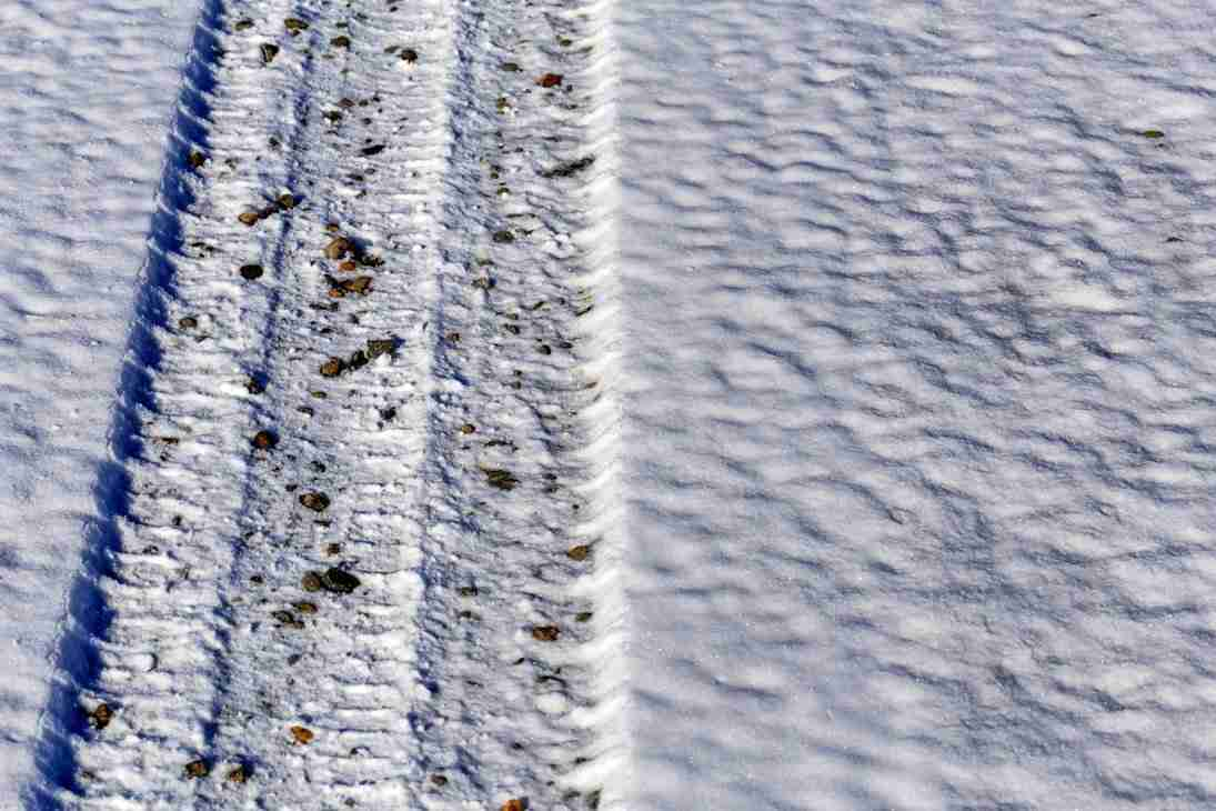 Print of a Tire Tread in the Snow Photo