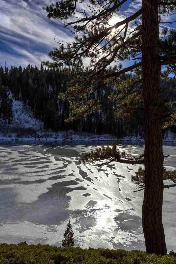 Print of Sun Reflecting on Ice Covered Echo Lake Photo