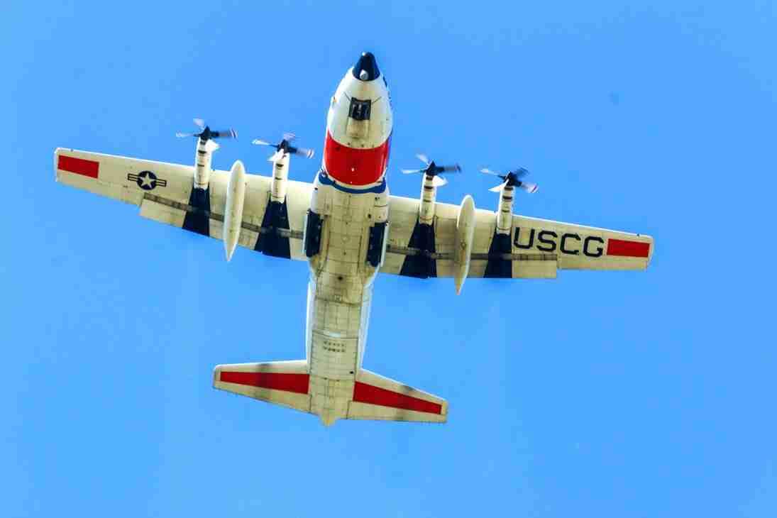 Print of a US Coast Guard Airplane Flying Overhead Photo