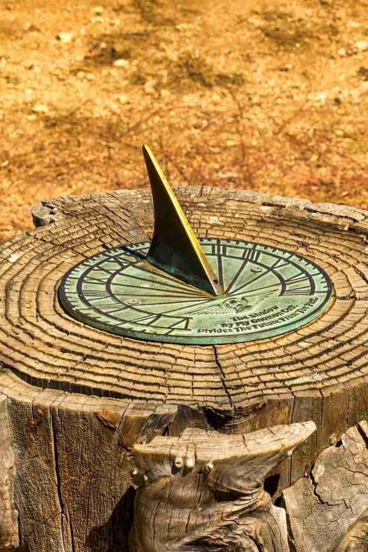 Print of a Sundial Embedded in a Tree Stump at Oak Glen Photo
