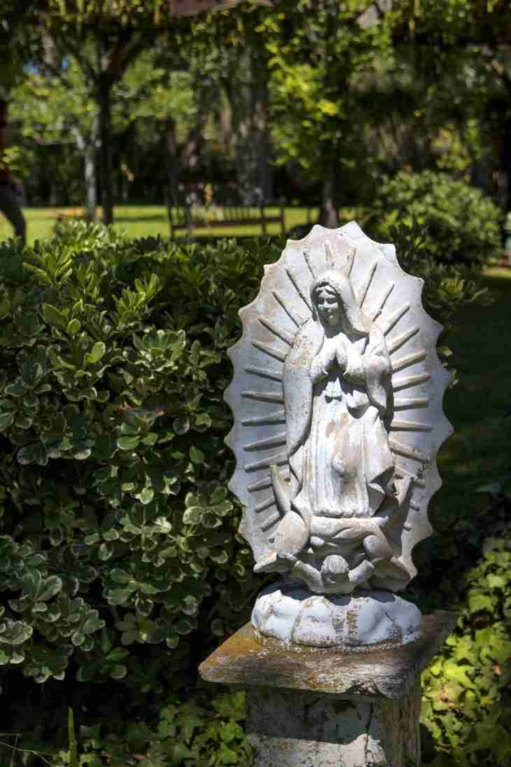 Print of a Sunlit Statue of the Virgin Mary Photo