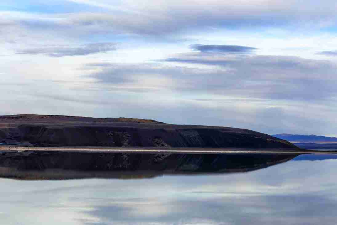 Print of a Dark Hill and Clouds Reflecting in Mono Lake Photo