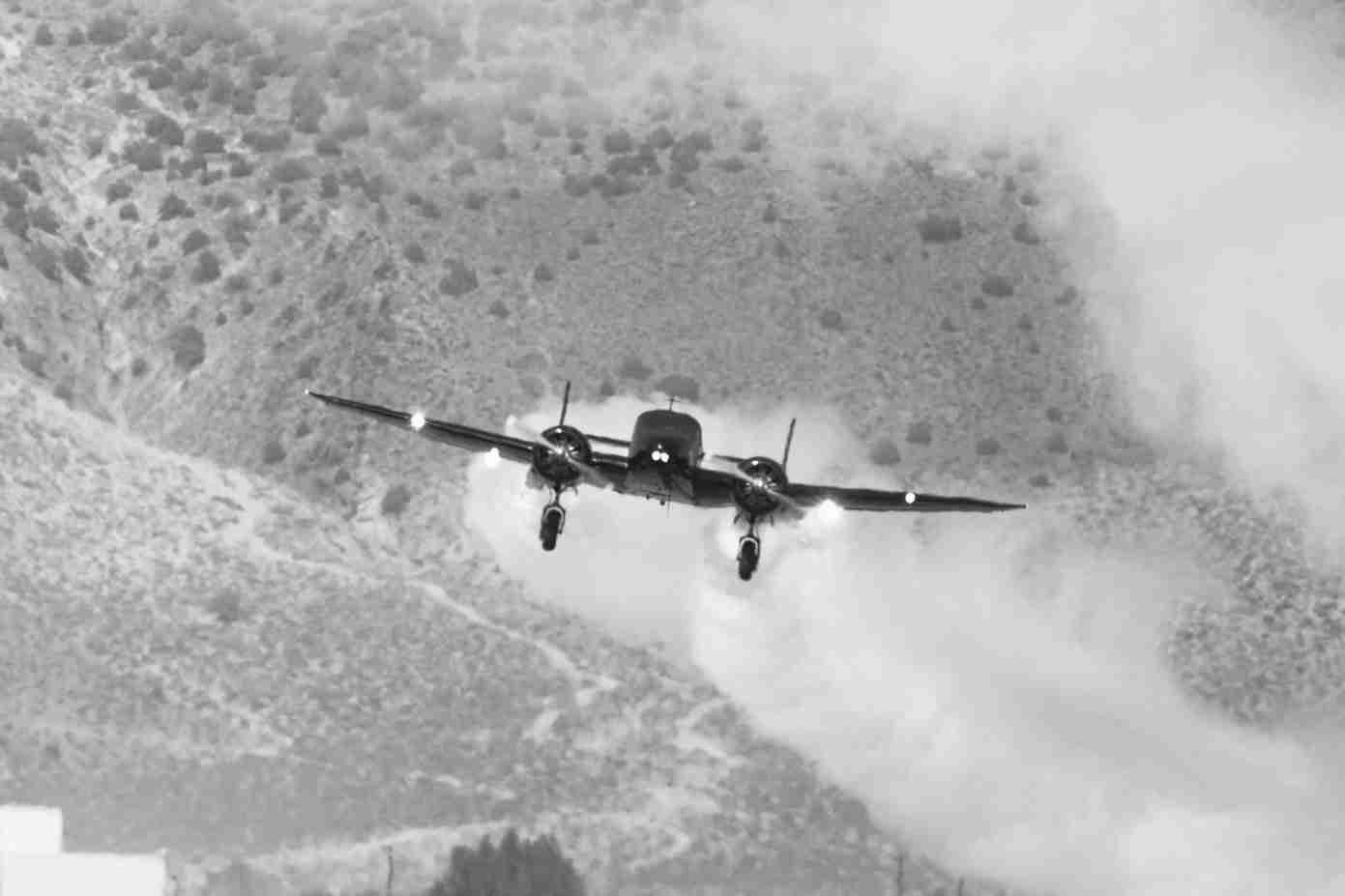 Black & White Photo of a Beech 18 Plane Finishing a Loop