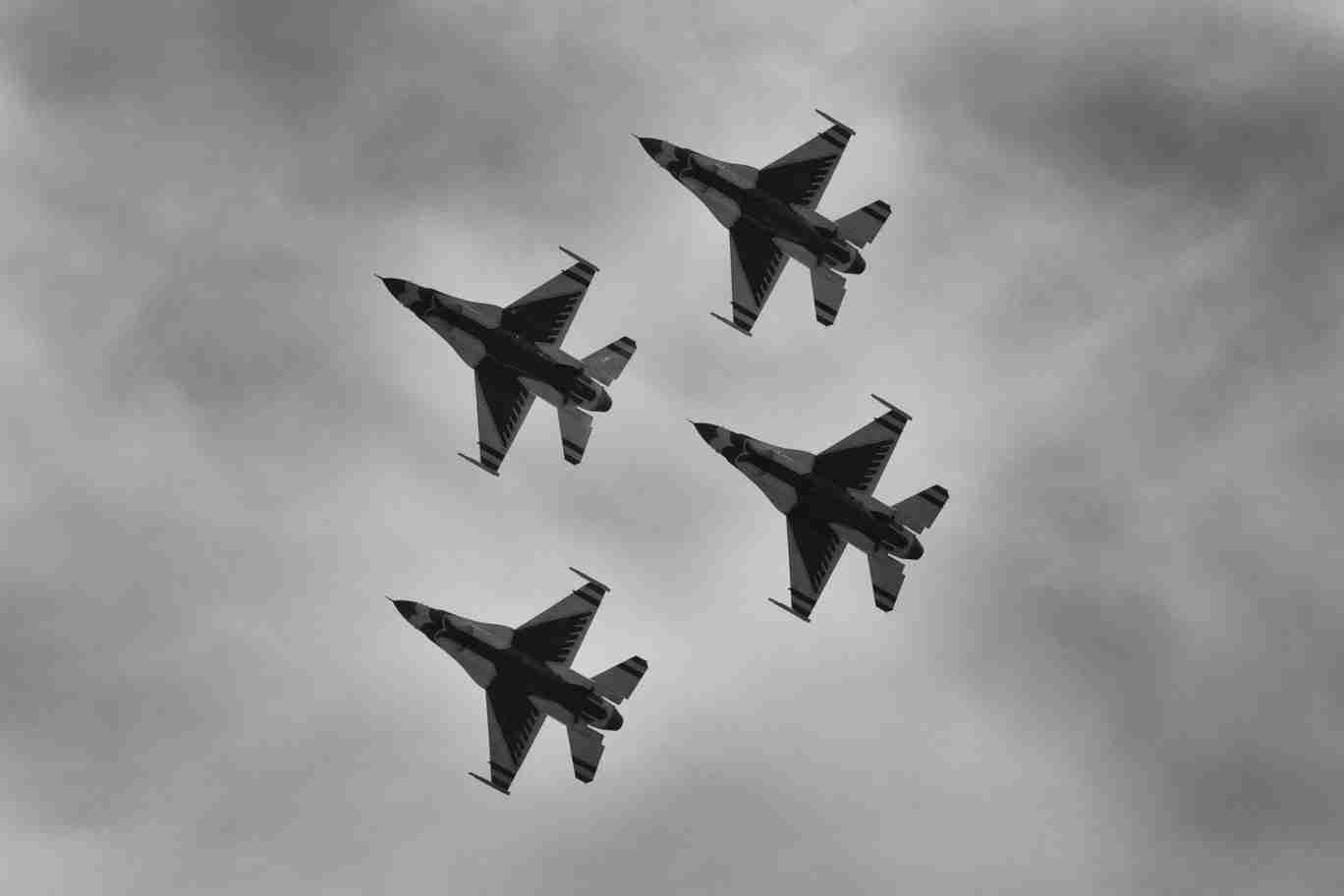 Black & White Photo of Air Force Thunderbird F-16s Flying Overhead