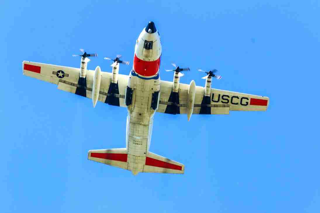 Print of a US Coast Guard Airplane Flying Overhead Photo