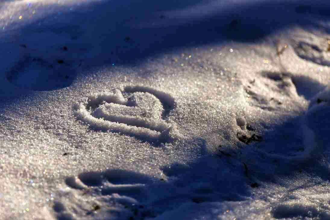 Print of a Heart Written in Snow Photo